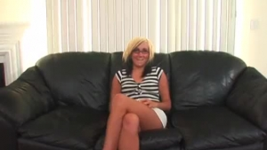 Naked babe has big, black glasses, and super sexy, blue haired girlfriend to rub her wet pussy