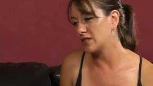 Dark haired woman was getting a relaxing massage, and now she wants some footjob in return