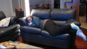 Kinky beauty gets pounded on the couch by her partner who is next door